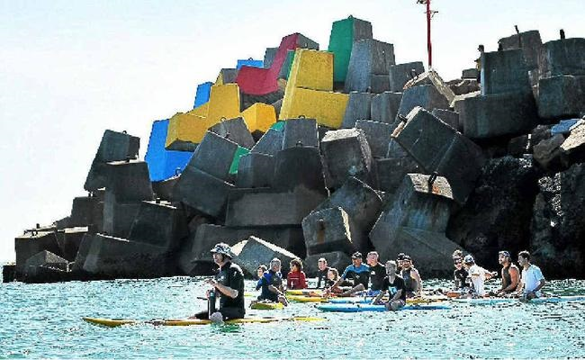 Surfers Paddle for Poverty